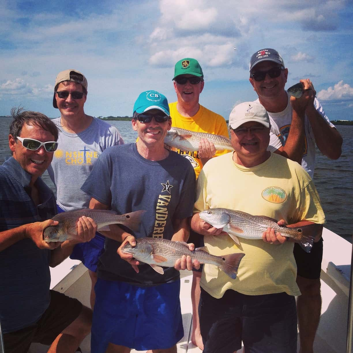 Guys fishing trip in tampa bay goes well with shallow for Fish and trip